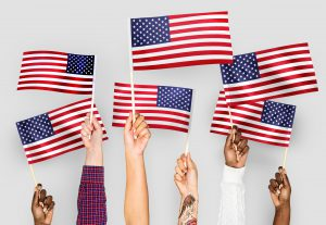 Photo of people holding small United States flags