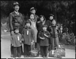 A Dorothea Lange photograph of a Japanese family relocated in 1942