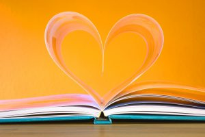 Image of a book with pages making the shape of a heart
