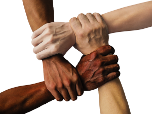 Image of people with different colored skin holding hands