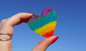 Photo of person holding a rainbow heart