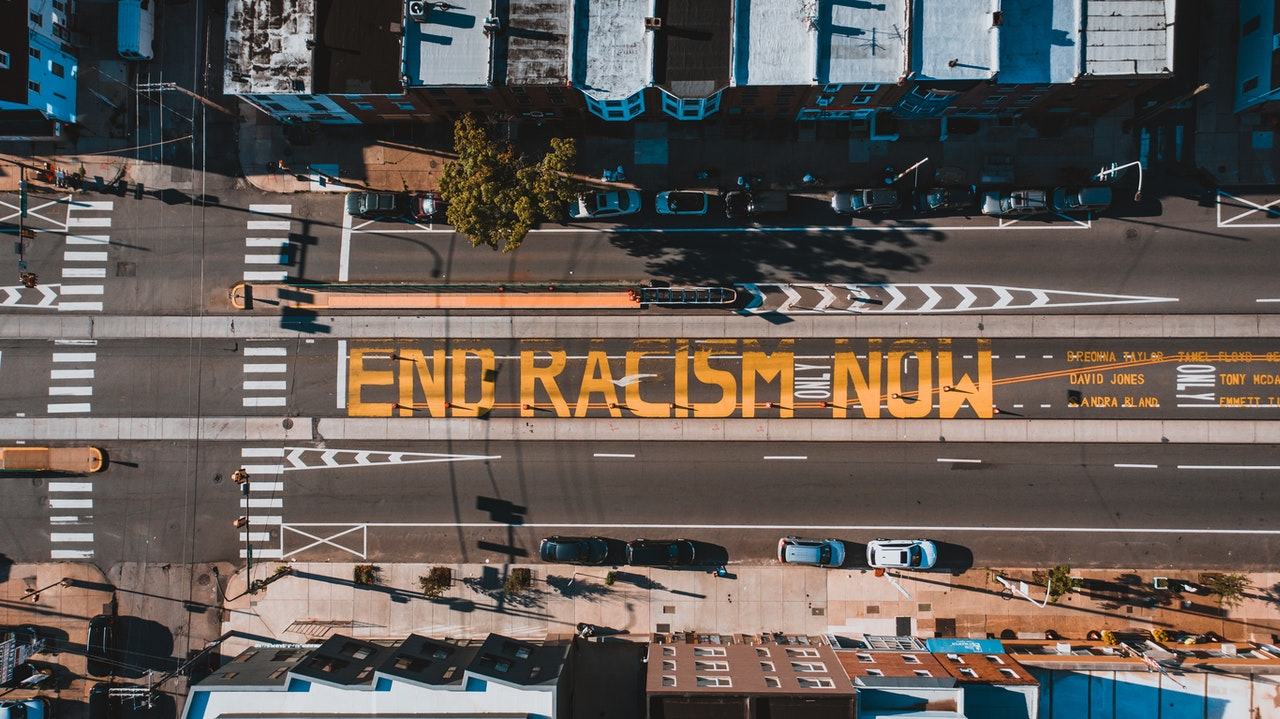 Photo with End Racism Now written on a street