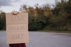 Love shouldn't hurt sign